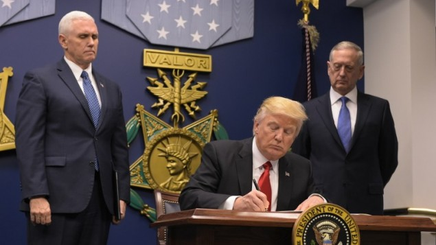 Officials: New Trump order drops Iraq from travel ban list