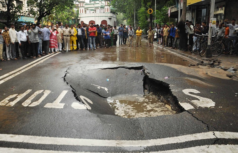 Road caves in due to heavy rainfall in Mumbai