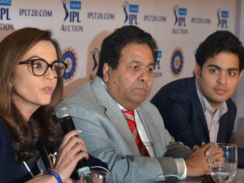 Mumbai Indians' owners Nita Ambani (left) and Akash Ambani (right) with Rajeev Shukla, the IPL Chairman, during the auction.