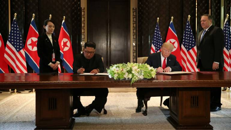 Trump, Kim sign 'comprehensive document' after historic summit