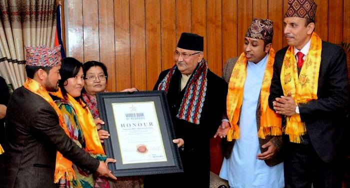 Prime Minister of Nepal KP Sharma Oli hands over the certificate of World Books of Records to Safalta HIV Sikshya Sadan