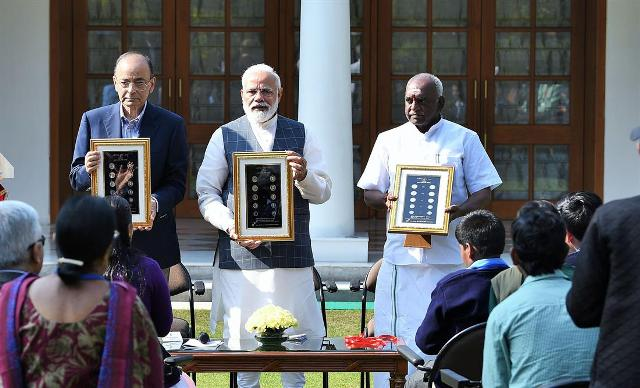 PM Modi releases new series of visually impaired friendly coins