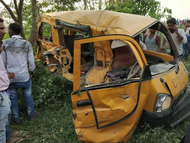 13 children killed as train hits school van at unmanned crossing