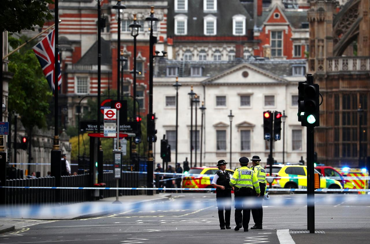 Car crashes outside British Parliament, 2 hurt; man held on suspicion of terror offences