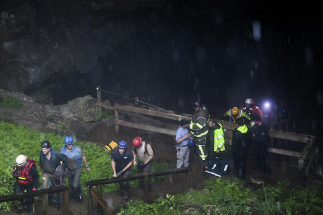 Pitch black cave, neck-deep water: How 19 people escaped a flash-flood